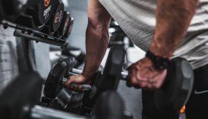 Man picking up weights